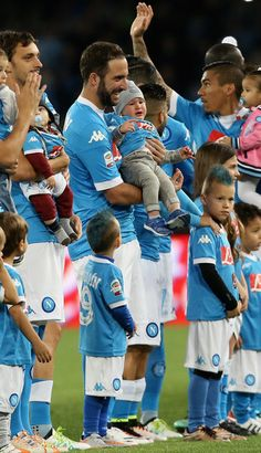 Gonzalo Higuain of Napoli with his son prior the Serie A match between SSC Napoli and Frosinone Calcio at Stadio San Paolo on May 14, 2016 in Naples, Italy.