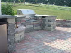 Built in gas grill space made from concrete cobble block. Natural bluestone provides the counter top.