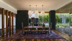 Exquisite modern dining room with captivating light fixtures