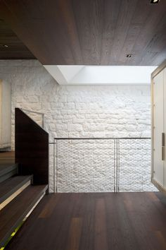 Maison Escalier / Moussafir Architectes Associés contrast between rugged stone and timber, contrast in texture and colour