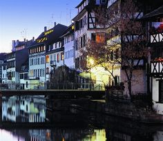 River running through Strasbourg, with houses on either side reflected in the water - Alsace Lorraine, home of the Mumme side of my family until the late 19th century.