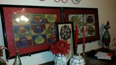 Art is in the eye of the beholder in this case, to make pieces the right size, I framed 2 placemats.  The red fabric is a textured shower curtain that I decided wouldn't work. I bought the frames at Michael's using coupons.