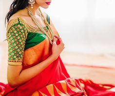 South Indian bride. Gold Indian bridal jewelry.Temple jewelry. Jhumkis. Red silk kanchipuram sari with contrast green blouse.Braid with fresh flowers. Tamil bride. Telugu bride. Kannada bride. Hindu bride. Malayalee bride.Kerala bride.South Indian wedding.