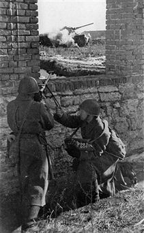 World War Two. Red Army soldiers with an anti-tank rifle, firing on a German tank on the Southwestern Front. Pin by Paolo Marzioli