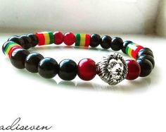 Rasta Colored bead bracelet with black beads and Lion head charm