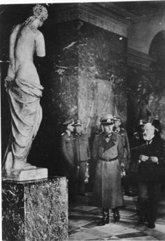 Curator of the Louvre Fernand Merlin giving German Field Marshal Gerd von Rundstedt a tour of the museum, Paris, Oct 1940.