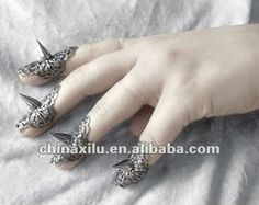 The fierce set of Gothic Finger Rings are Victorian style lace filigree in antiqued sterling silver plates, meant to hold the shape of your finger, with the shiny metal spike focal piece asserting itself on the front. Gothic 3, Gothic Rings, Gothic Jewelry, Unique Jewelry, Diy Jewelry, Armor Ring, Metal Spikes, Nail Ring, Queen Costume