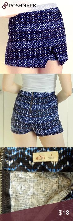 Hollister blue and white shorts/skirt Really cute pair of shorts with a extra skirt-like asymmetrical layer on the front. Great for a summer look - pair with a fancy blouse to dress it up, or a white distressed tee to dress it down.  Lightly used condition, but no visible flaws. Let me know if you have any questions! Hollister Shorts Skorts