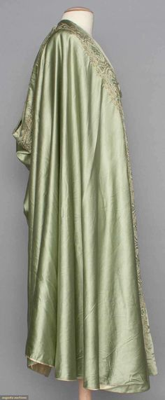 EMBROIDERED LIBERTY BURNOOSE, c. 1910 Celadon green satin charmeuse, cotton embroidery in shades of green & tan w/ paste jewels, lined in ivory silk,