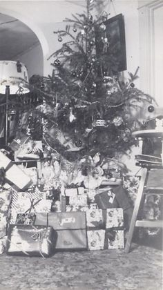 1940's Christmas Day morning. Santa has come and left loads of presents.