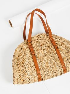 Half Moon Straw Tote | In a semi-circle shape, this straw tote features faux leather top handles. * Zip top closure * Lined interior with slip pockets