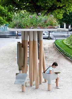 Wifi Hotspot / Landscape art, Paris by designer Matheiu Lehanneur.  Seats are concrete with built in electrical outlets.