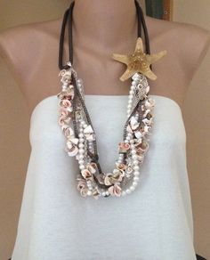 Handmade sea shell necklace with Freshwater pearls and  copper chain. via Etsy.