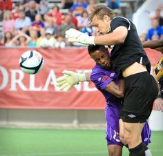 Orlando City's Dennis Chin (15) collides with Charleston goal keeper Andrew Dykstra (0) during first half action of a United Soccer League Pro match against Charleston Battery at the Florida Citrus Bowl in Orlando, Fla. on Saturday, June 9, 2012.
