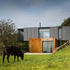 Grillagh Water House by Patrick Bradley is  made up of four stacked shipping containers