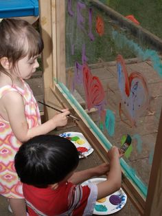DIY Outdoor art easel for kids made from plexiglass. Paint washes away easy with a hose (which could also be fun for the kids) no paint mess in the house