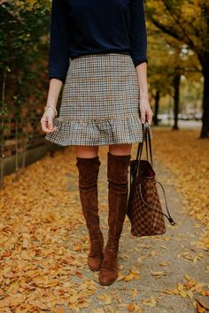 J.Crew Houndstooth Peplum Skirt. It runs a little big but I like it that way. I can tuck in my sweaters easily. Also wearing Over-the-Knee Boots in brown in low and high heel. Louis Vuitton Tote too!