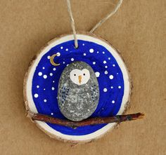 Night owl, painted rock on wood slice, ornament, night sky, children's art, pebble, round, blue and white, stars,, owl on branch, stick