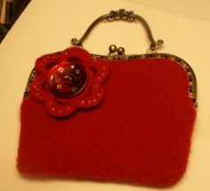 Red Noni Bag  Knitted, felted and sewn into the brass handle. The button makes the bag.