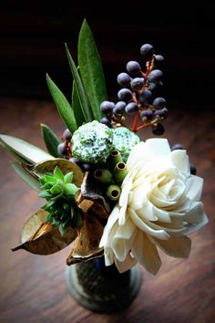 Style Sweets Editors Pick:Without whitw Designed by Bare Root Flora. Boutonniere of eucalyptus, berries