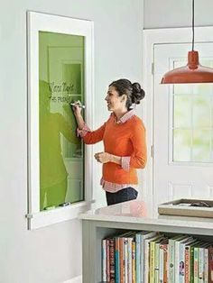 Paint the back of a piece glass a bright color then frame and use it as a colorful dry erase board.