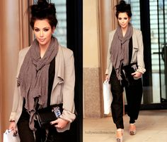 Classy bun with a long scarf, cardigan, and black pants to go along with it.