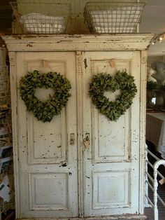 Heart wreaths on a chippy cupboard...