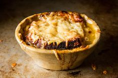 French Onion Soup  Serves 4, robustly    6  large yellow onions, sliced thinly  1  cup heavy cream  2  tablespoons unsalted butter  1  teaspoon salt  2  cups dry white wine  2  quarts chicken stock  5  ounces Gruyere cheese, grated (a Cheddar would work, too)  4  slices of hole-y, country bread
