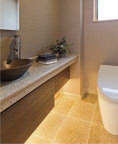 カウンターと床仕上に御影石を使用した和風のトイレ空間です。|タイル|インテリア|おしゃれ|ライト|トイレ|
