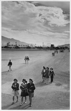 Gladys Matsumoto, 16, center, Shizuko Sakihara, 16, left, and Judy Nakao, 17, walk home from school at the Manzanar Internment Camp. Matsumoto was born in Elk Grove, Calif. where her family farmed Her father, Shigeruoka also had a grocery store, the Davis Highway Market in West Sacramento run by his two older sons. Photo by Ansel Adams