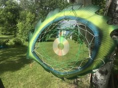 A tire cut and woven with a dream catcher made to resemble an eye. Also helps keep woodpeckers off trees.!