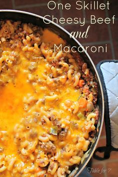 "table for seven: One Skillet Cheesy Beef and Macaroni- I'm not sure how giant the author's skillet was, but this did NOT fit in my 12"" one...I dumped it into a Dutch oven in order to add the liquid and macaroni. I would cut the liquid back a bit on next try, but it was quite tasty over all."