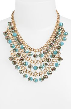 Free shipping and returns on Cara Bib Necklace at Nordstrom.com. A goldtone series of bead-tipped curb chains form a glittering bib for a handcrafted statement necklace.