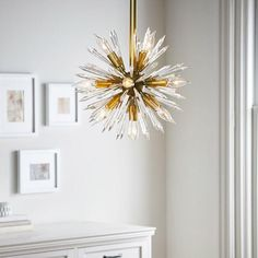 Lighting - This pendant light adds chic style to your room with its modern shape and lively design. An artful focal point, it's a bold and playful accent to any decor.
