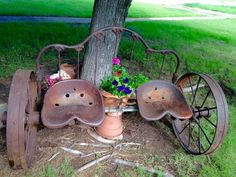 Old iron headboard, wheels and tractor seats repurposed into a bench. Horse shoes serve as drink holders.