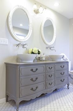 Stunning Bathroom Tour + Dresser into Double Vanity How to turn a vintage french dresser into a double sink vanity. Includes tips, paint color used, and best non-yellowing, waterproof top coat for a bathroom. Baños Shabby Chic, Shabby Chic Homes, Diy Bathroom Vanity, Vanity Sink, Dresser Sink, Top Mount Bathroom Sink, Large Dresser, Vanity Room, Vessel Sink Bathroom