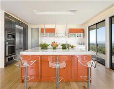 Love this modern orange kitchen by Mark English