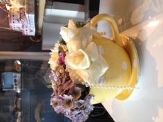 Mad hatters tea party. Oversized teacups filled with blousy roses and chrysanthemums. We love this. A. X