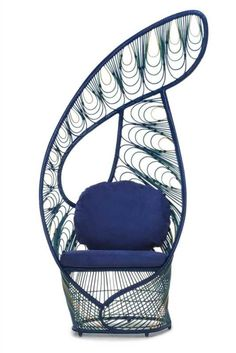 Kenneth Cobonpue - Beautiful in iridescent green and blue, Peacock is a modern take on the traditional wicker chair. Like the regal bird, this lounge chair truly stands out among the flock. #DesignOnHPMkt #HPMKT