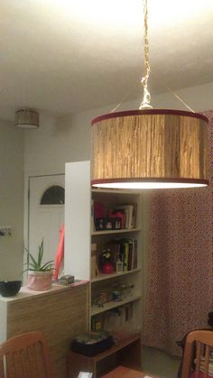 DIY drum shade to hide an ugly pendant lamp is just one of the ways you can upgrade your lighting as a renter! #EYSINSPIRED drum shade pendant lamp made by Maria