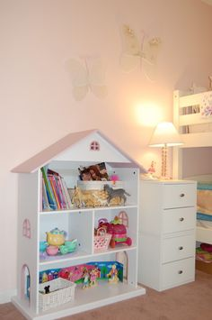 I've seen this as Target.  Bookshelf and dollhouse in one!