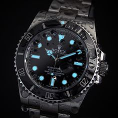 Crazy wet lume shot of @rolexdiver's 114060 No Date Rolex Submariner by rolexaholics