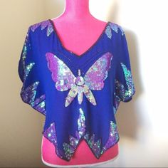 Free People Cobalt Iridescent Butterfly Top Light-reflecting sequins. Sparkling butterfly design on the front and back. Drapey chiffon top. Cropped, asymmetrical hem that's ideal for layering. Free People Tops