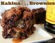Kahlua Kiss Brownies: 1-1 lb. box of Brownie Mix 1-11 oz. bag of Caramel Hershey's Kisses Enough Kahlua to replace the water that's called for in your box of Brownies A square baking pan