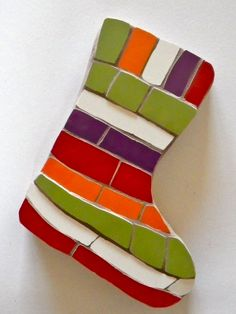 A mosaic stocking wall hanging from www.justmosaics.co.uk