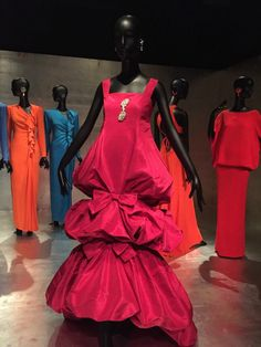 """Dresses worn by French style and fashion icon Jacqueline de Ribes are displayed at the Costume Institute at the Metropolitan Museum of Art on Monday, Nov. 16, 2015 in New York. The exhibit, """"Jacqueline de Ribes: The Art of Style,"""" opens on November 19.  (AP Photo/Jocelyn Noveck)"""