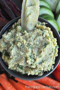 Easily create hummus with real food and clean ingredients at home in just minutes with this Spinach Artichoke Hummus recipe.