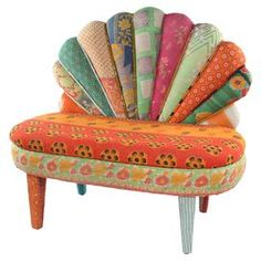 """Mango wood bench upholstered with one-of-a-kind vintage kantha throws.  Product: ChairConstruction Material: Mango wood, reclaimed kantha and fabricColor: MultiFeatures: One-of-a-kindDimensions: 36"""" H x 40"""" W x 22"""" DCleaning and Care: Spot clean"""