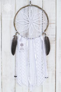 This large doily dreamcatcher will make a great decorative touch to any space. Perfect for boho wedding ceremony decoration. The same time it can be an ideal gift for a birthday or in any other occasion.  •  Diameter - 10 (25cm)  |  Length - 25 (63cm) not including hanging ribbon. •  The doily lace is individually knitted from cotton thread •  The hoop is hand made from bamboo rods •  Various carefully selected vintage ribbon and lace hang from the bottom •  I use natural pheasant feathers…