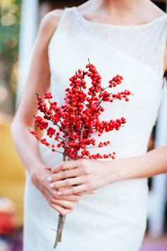 Bouquet option: Have your bridesmaids carry simple holly rather than a floral bouquet.